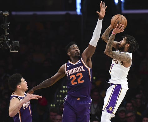 Dec 2, 2018; Los Angeles, CA, USA; Los Angeles Lakers forward Brandon Ingram (14) shoots a jump shot over Phoenix Suns center Deandre Ayton (22) in the second quarter at Staples Center. Mandatory Credit: Robert Hanashiro-USA TODAY Sports