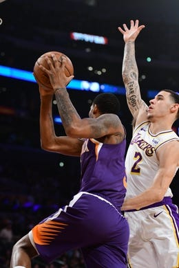 Dec 2, 2018; Los Angeles, CA, USA; Phoenix Suns forward Trevor Ariza (3) looks to pass pass as he is defended by Los Angeles Lakers guard Lonzo Ball (2) in the first quarter at Staples Center. Mandatory Credit: Robert Hanashiro-USA TODAY Sports