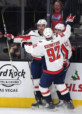 Dec 4, 2018; Las Vegas, NV, USA; Washington Capitals left wing Jakub Vrana (13) celebrates with center Evgeny Kuznetsov (92) and right wing Brett Connolly (10) after scoring a first period goal against the Vegas Golden Knights and  at T-Mobile Arena. Mandatory Credit: Stephen R. Sylvanie-USA TODAY Sports