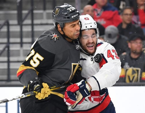 Dec 4, 2018; Las Vegas, NV, USA; Vegas Golden Knights right wing Ryan Reaves (75) checks Washington Capitals right wing Tom Wilson (43) during the first period at T-Mobile Arena. Mandatory Credit: Stephen R. Sylvanie-USA TODAY Sports