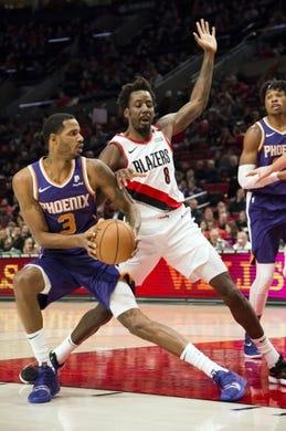 Dec 6, 2018; Portland, OR, USA; Phoenix Suns forward Trevor Ariza (3) stops to shoot a basket against Portland Trail Blazers forward Al-Farouq Aminu (8) during the first half at Moda Center. Mandatory Credit: Troy Wayrynen-USA TODAY Sports
