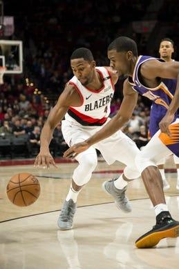 Dec 6, 2018; Portland, OR, USA; Portland Trail Blazers forward Maurice Harkless (4) steals the ball away from Phoenix Suns forward Josh Jackson (20) during the first half at Moda Center. Mandatory Credit: Troy Wayrynen-USA TODAY Sports