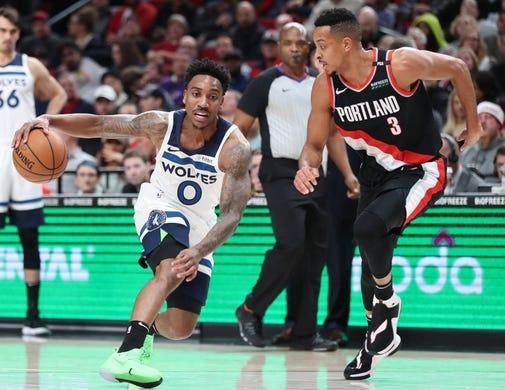 Dec 8, 2018; Portland, OR, USA;  Minnesota Timberwolves guard Jeff Teague (0) dribbles by Portland Trail Blazers guard CJ McCollum (3) in the first half at Moda Center. Mandatory Credit: Jaime Valdez-USA TODAY Sports