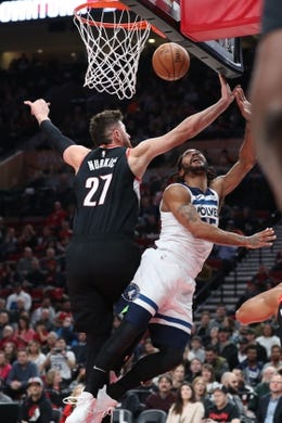Dec 8, 2018; Portland, OR, USA;  Minnesota Timberwolves guard Derrick Rose (25) reacts after having his shot blocked by Portland Trail Blazers center Jusuf Nurkic (27) in the first half at Moda Center. Mandatory Credit: Jaime Valdez-USA TODAY Sports