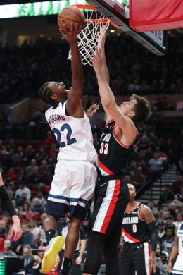 Dec 8, 2018; Portland, OR, USA; Minnesota Timberwolves forward Andrew Wiggins (22) shoots over Portland Trail Blazers forward Zach Collins (33) in the first half at Moda Center. Mandatory Credit: Jaime Valdez-USA TODAY Sports