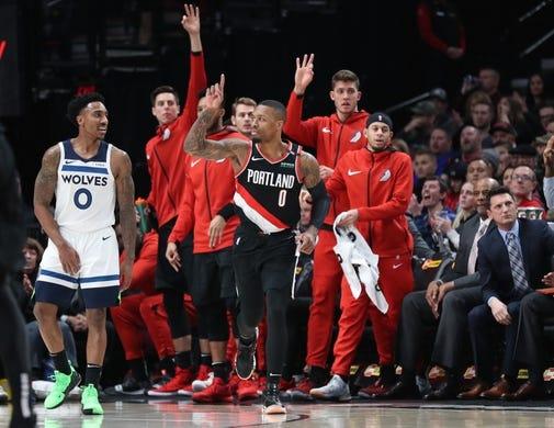 Dec 8, 2018; Portland, OR, USA;  Portland Trail Blazers guard Damian Lillard (0) raises his finger after scoring over Minnesota Timberwolves in the first half at Moda Center. Mandatory Credit: Jaime Valdez-USA TODAY Sports