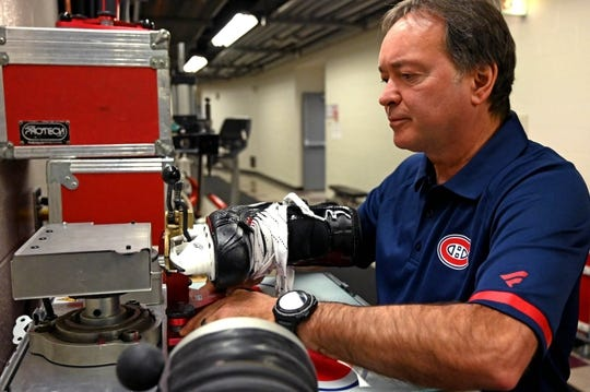 Dec 9, 2018; Chicago, IL, USA; Montreal Canadiens head equipment manager Pierre Gervais sharpens skates prior to a game against the Chicago Blackhawks at United Center. Mandatory Credit: Patrick Gorski-USA TODAY Sports