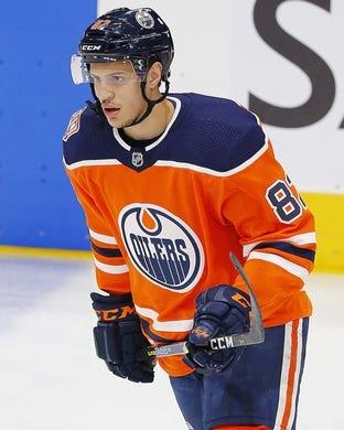 Dec 14, 2018; Edmonton, Alberta, CAN; Edmonton Oilers defensemen Caleb Jones (82) skates during warmup against the Philadelphia Flyers at Rogers Place. Mandatory Credit: Perry Nelson-USA TODAY Sports
