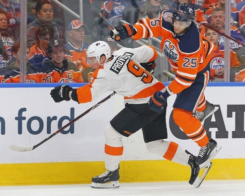 Dec 14, 2018; Edmonton, Alberta, CAN; Edmonton Oilers defensemen Darnell Nurse (25) jumps out of the way of a check from Philadelphia Flyers defensemen Ivan Provorov (9) during the first period at Rogers Place. Mandatory Credit: Perry Nelson-USA TODAY Sports