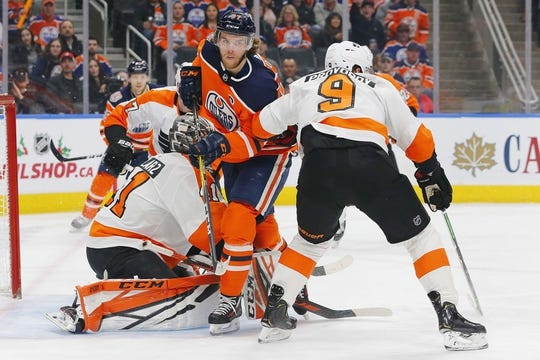 Dec 14, 2018; Edmonton, Alberta, CAN; Philadelphia Flyers goaltender Anthony Stolarz (41) makes a save on Edmonton Oilers forward Connor McDavid (97) during the first period at Rogers Place. Mandatory Credit: Perry Nelson-USA TODAY Sports