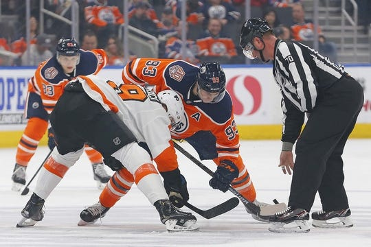 Dec 14, 2018; Edmonton, Alberta, CAN; Edmonton Oilers forward Ryan Nugent-Hopkins (93) wins a face-off against Philadelphia Flyers forward Patrick Nolan (19) during the first period at Rogers Place. Mandatory Credit: Perry Nelson-USA TODAY Sports