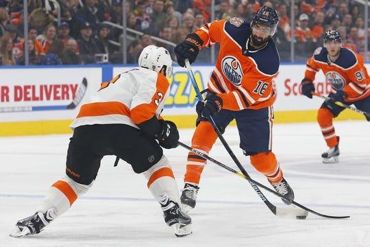 Dec 14, 2018; Edmonton, Alberta, CAN; Philadelphia Flyers defensemen Radko Gudas (3) tries to block a shot by Edmonton Oilers forward Jujhar Khaira (16) during the first period at Rogers Place. Mandatory Credit: Perry Nelson-USA TODAY Sports