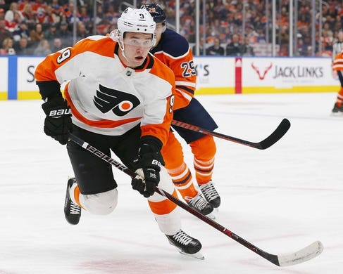 Dec 14, 2018; Edmonton, Alberta, CAN;  Philadelphia Flyers defensemen Ivan Provorov (9) and Edmonton Oilers forward Leon Draisaitl (29) chase a loose puck during the first period at Rogers Place. Mandatory Credit: Perry Nelson-USA TODAY Sports