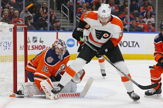 Dec 14, 2018; Edmonton, Alberta, CAN; Philadelphia Flyers forward James van Riemsdyk (25) deflects a shot wide of Edmonton Oilers goaltender Mikko Koskinen (19) during the second period at Rogers Place. Mandatory Credit: Perry Nelson-USA TODAY Sports