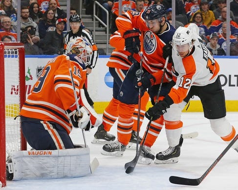 Dec 14, 2018; Edmonton, Alberta, CAN; Edmonton Oilers goaltender Mikko Koskinen (19) makes a save on Philadelphia Flyers forward Michael Raffl (12) during the second period at Rogers Place. Mandatory Credit: Perry Nelson-USA TODAY Sports