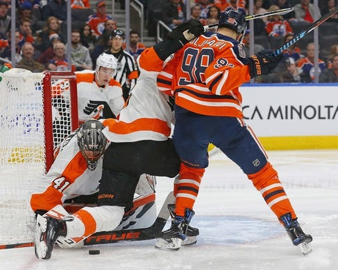 Dec 14, 2018; Edmonton, Alberta, CAN; Edmonton Oilers forward Jesse Puljujarvi (98) looks for a rebound in front of Philadelphia Flyers goaltender Anthony Stolarz (41) during the third period at Rogers Place. Mandatory Credit: Perry Nelson-USA TODAY Sports