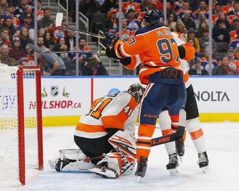 Dec 14, 2018; Edmonton, Alberta, CAN;  Edmonton Oilers forward Connor McDavid (97) battle with Philadelphia Flyers forward Patrick Nolan (19) in front of goaltender Anthony Stolarz (41) during the third period at Rogers Place. Mandatory Credit: Perry Nelson-USA TODAY Sports