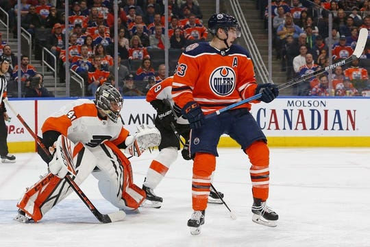 Dec 14, 2018; Edmonton, Alberta, CAN; Edmonton Oilers forward Ryan Nugent-Hopkins (93) tries to screen Philadelphia Flyers goaltender Anthony Stolarz (41) during the third period at Rogers Place. Mandatory Credit: Perry Nelson-USA TODAY Sports
