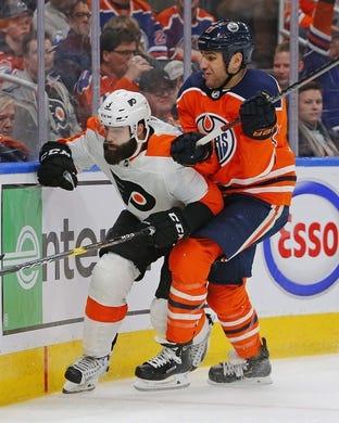 Dec 14, 2018; Edmonton, Alberta, CAN; Edmonton Oilers forward Milan Lucic (27) checks Philadelphia Flyers defensemen Radko Gudas (3) during the third period at Rogers Place. Mandatory Credit: Perry Nelson-USA TODAY Sports