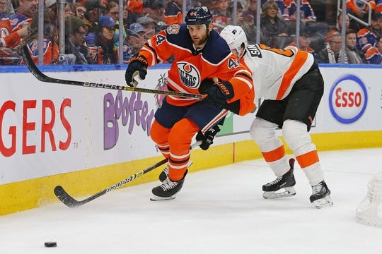 Dec 14, 2018; Edmonton, Alberta, CAN; Edmonton Oilers forward Zack Kassian (44) and Philadelphia Flyers defensemen Travis Sanheim (6) chess loose puck during the third period at Rogers Place. Mandatory Credit: Perry Nelson-USA TODAY Sports