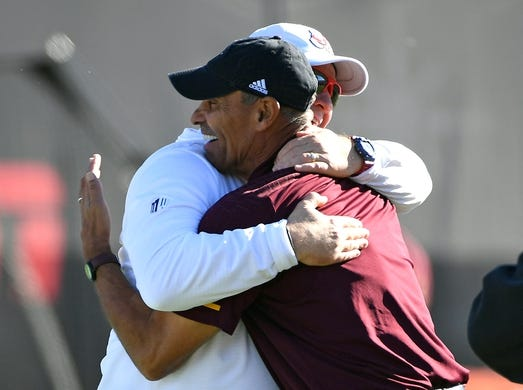 Dec 15, 2018; Las Vegas, NV, United States; Fresno State Bulldogs head coach Jeff Tedford embraces Arizona State Sun Devils head coach Herm Edwards before the start of the Las Vegas Bowl at Sam Boyd Stadium. Mandatory Credit: Stephen R. Sylvanie-USA TODAY Sports