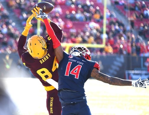 Dec 15, 2018; Las Vegas, NV, United States; Fresno State Bulldogs defensive back Jaron Bryant (14) breaks up a reception attempt by Arizona State Sun Devils wide receiver Frank Darby (84) during the first half at Sam Boyd Stadium. Mandatory Credit: Stephen R. Sylvanie-USA TODAY Sports