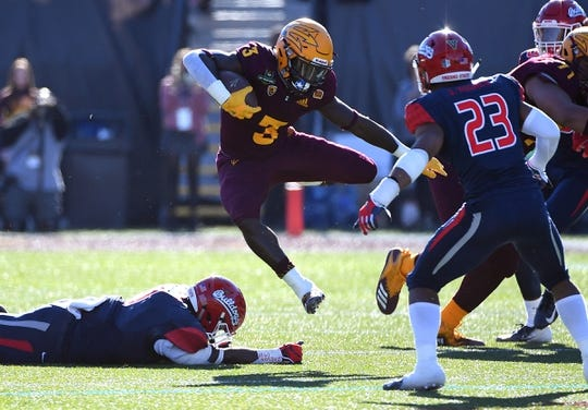 Dec 15, 2018; Las Vegas, NV, United States; Arizona State Sun Devils running back Eno Benjamin (3) hurdles a Fresno State Bulldogs tackler during the first half at Sam Boyd Stadium. Mandatory Credit: Stephen R. Sylvanie-USA TODAY Sports
