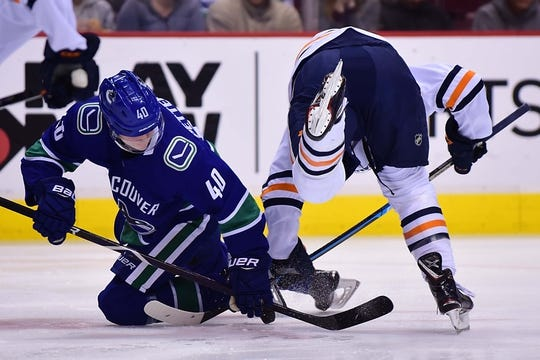 Dec 16, 2018; Vancouver, British Columbia, CAN; Vancouver Canucks forward Elias Pettersson (40) faces off against Edmonton Oilers forward Connor McDavid (97) during the first period at Rogers Arena. Mandatory Credit: Anne-Marie Sorvin-USA TODAY Sports