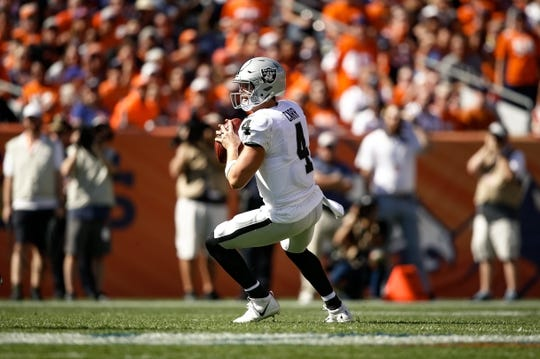 Sep 16, 2018; Denver, CO, USA; Oakland Raiders quarterback Derek Carr (4) drops back to pass in the first quarter against the Denver Broncos at Broncos Stadium at Mile High. Mandatory Credit: Isaiah J. Downing-USA TODAY Sports