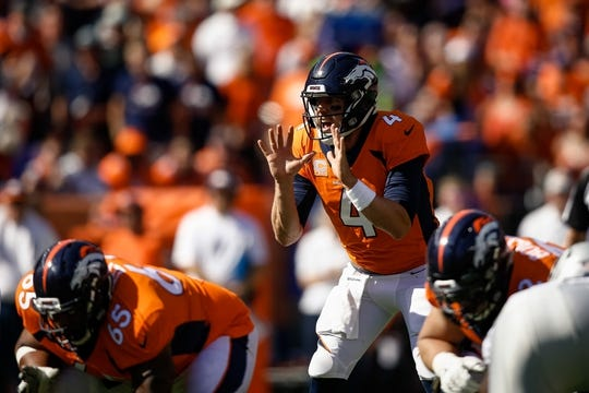 Sep 16, 2018; Denver, CO, USA; Denver Broncos quarterback Case Keenum (4) at the line of scrimmage in the second quarter against the Oakland Raiders at Broncos Stadium at Mile High. Mandatory Credit: Isaiah J. Downing-USA TODAY Sports