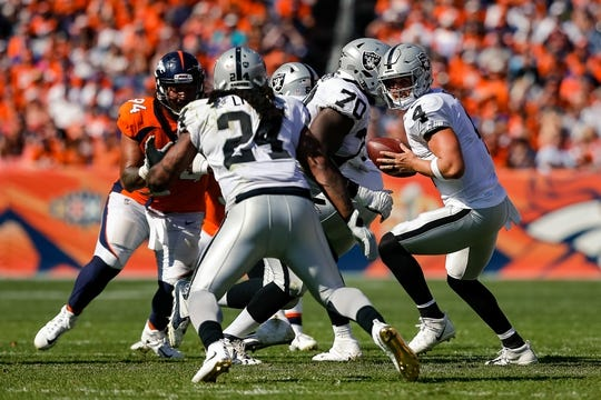 Sep 16, 2018; Denver, CO, USA; Denver Broncos nose tackle Domata Sr. Peko (94) rushes as Oakland Raiders quarterback Derek Carr (4) drops back and running back Marshawn Lynch (24) runs in the second quarter at Broncos Stadium at Mile High. Mandatory Credit: Isaiah J. Downing-USA TODAY Sports