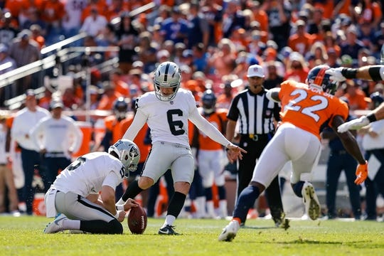 Sep 16, 2018; Denver, CO, USA; Denver Broncos cornerback Tramaine Brock (22) defends on a kick from Oakland Raiders kicker Mike Nugent (6) as punter Johnny Townsend (5) holds in the second quarter at Broncos Stadium at Mile High. Mandatory Credit: Isaiah J. Downing-USA TODAY Sports