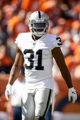 Sep 16, 2018; Denver, CO, USA; Oakland Raiders safety Marcus Gilchrist (31) in the first quarter against the Denver Broncos at Broncos Stadium at Mile High. Mandatory Credit: Isaiah J. Downing-USA TODAY Sports