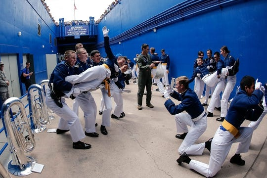 Sep 1, 2018; Colorado Springs, CO, USA; Members of the United States Air Force Academy Drum and Bugle Corp play for fans as they watch above the entrance tunnel before the game between the Air Force Falcons and the Stony Brook Seawolves at Falcon Stadium. Mandatory Credit: Isaiah J. Downing-USA TODAY Sports