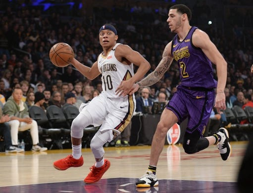 December 21, 2018; Los Angeles, CA, USA; New Orleans Pelicans guard Tim Frazier (10) moves to the basket against Los Angeles Lakers guard Lonzo Ball (2) during the first half at Staples Center. Mandatory Credit: Gary A. Vasquez-USA TODAY Sports