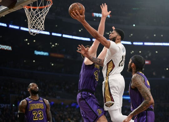 December 21, 2018; Los Angeles, CA, USA; New Orleans Pelicans forward Anthony Davis (23) moves to the basket against Los Angeles Lakers center Ivica Zubac (40) during the first half at Staples Center. Mandatory Credit: Gary A. Vasquez-USA TODAY Sports