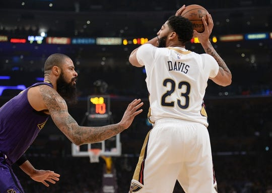 December 21, 2018; Los Angeles, CA, USA; New Orleans Pelicans forward Anthony Davis (23) controls the ball against Los Angeles Lakers center Tyson Chandler (5) during the first half at Staples Center. Mandatory Credit: Gary A. Vasquez-USA TODAY Sports