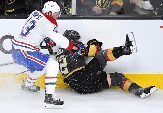 Dec 22, 2018; Las Vegas, NV, USA; Montreal Canadiens center Michael Chaput (43) checks Vegas Golden Knights defenseman Nick Holden (22) into the boards during the first period at T-Mobile Arena. Mandatory Credit: Stephen R. Sylvanie-USA TODAY Sports