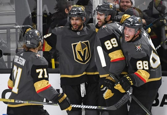 Dec 22, 2018; Las Vegas, NV, USA; Vegas Golden Knights players come together to celebrate a goal scored by Vegas Golden Knights center Brandon Pirri (73) during the first period against the Montreal Canadiens at T-Mobile Arena. Mandatory Credit: Stephen R. Sylvanie-USA TODAY Sports