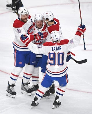 Dec 22, 2018; Las Vegas, NV, USA; Montreal Canadiens players come together to celebrate a goal by center Phillip Danault (24) during the first period against the Vegas Golden Knights at T-Mobile Arena. Mandatory Credit: Stephen R. Sylvanie-USA TODAY Sports