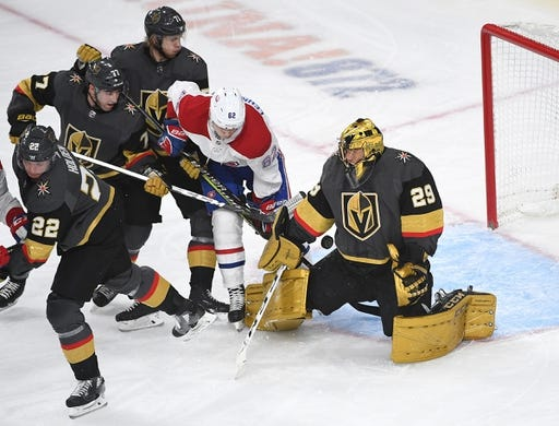 Dec 22, 2018; Las Vegas, NV, USA; Vegas Golden Knights goaltender Marc-Andre Fleury (29) makes a first period save as Montreal Canadiens left wing Artturi Lehkonen (62) looks for the rebound during the first period at T-Mobile Arena. Mandatory Credit: Stephen R. Sylvanie-USA TODAY Sports