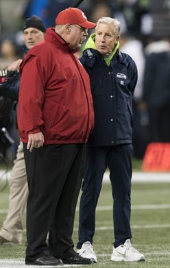 Dec 23, 2018; Seattle, WA, USA; Kansas City Chiefs head coach Andy Reid and Seattle Seahawks head coach Pete Carroll talk prior to the game at CenturyLink Field. Mandatory Credit: Steven Bisig-USA TODAY Sports