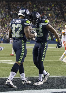 Dec 23, 2018; Seattle, WA, USA; Seattle Seahawks running back Chris Carson (32) and  wide receiver David Moore (83) celebrate after Carson scored a touchdown against the Kansas City Chiefs during the first half at CenturyLink Field. Mandatory Credit: Steven Bisig-USA TODAY Sports