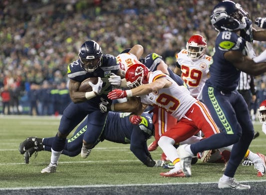 Dec 23, 2018; Seattle, WA, USA; Seattle Seahawks running back Chris Carson (32) runs the ball in for a touchdown against the Kansas City Chiefs during the first half at CenturyLink Field. Mandatory Credit: Steven Bisig-USA TODAY Sports