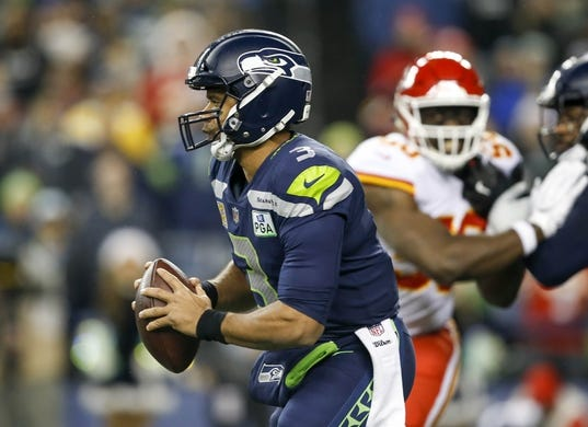 Dec 23, 2018; Seattle, WA, USA; Seattle Seahawks quarterback Russell Wilson (3) scrambles out of the pocket against the Kansas City Chiefs during the first quarter at CenturyLink Field. Mandatory Credit: Joe Nicholson-USA TODAY Sports