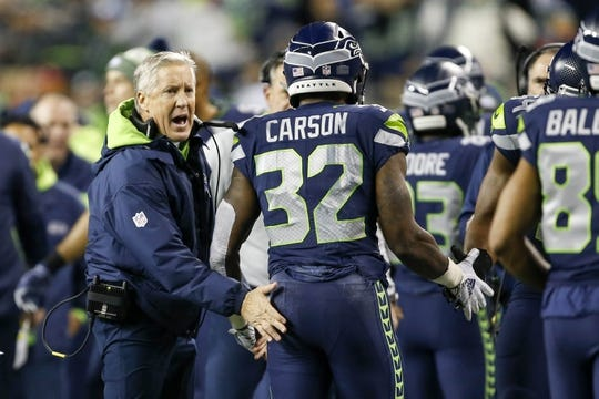 Dec 23, 2018; Seattle, WA, USA; Seattle Seahawks head coach Pete Carroll greets running back Chris Carson (32) on the sideline following a rushing touchdown by Carson against the Kansas City Chiefs during the first quarter at CenturyLink Field. Mandatory Credit: Joe Nicholson-USA TODAY Sports