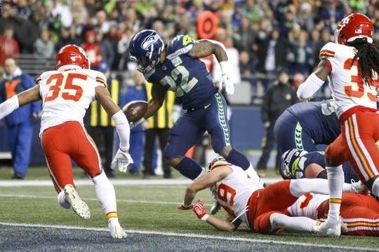 Dec 23, 2018; Seattle, WA, USA; Seattle Seahawks running back Chris Carson (32) rushes for a touchdown against the Kansas City Chiefs during the first quarter at CenturyLink Field. Mandatory Credit: Joe Nicholson-USA TODAY Sports
