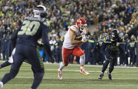 Dec 23, 2018; Seattle, WA, USA; Kansas City Chiefs tight end Travis Kelce (87) carries the ball after after catching a pass against the Seattle Seahawks during the first half at CenturyLink Field. Mandatory Credit: Steven Bisig-USA TODAY Sports