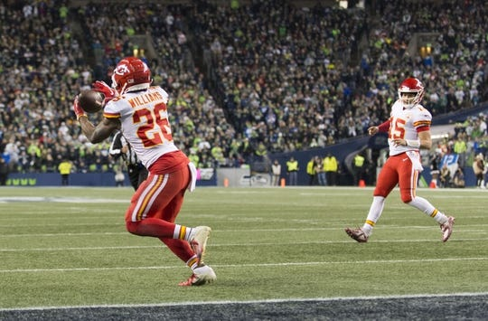 Dec 23, 2018; Seattle, WA, USA; Kansas City Chiefs running back Damien Williams (26) catches a pass from Kansas City Chiefs quarterback Patrick Mahomes (15) for a touchdown against the Seattle Seahawks during the first half at CenturyLink Field. Mandatory Credit: Steven Bisig-USA TODAY Sports