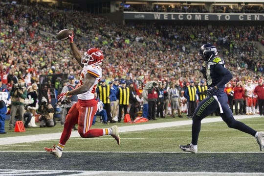 Dec 23, 2018; Seattle, WA, USA; Kansas City Chiefs running back Damien Williams (26) scores a touchdown against the Seattle Seahawks during the first half at CenturyLink Field. Mandatory Credit: Steven Bisig-USA TODAY Sports